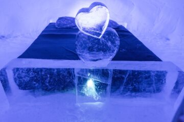ice hotel bed with ice heart